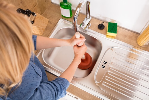 Why do I need a plumber to clear a clogged drain