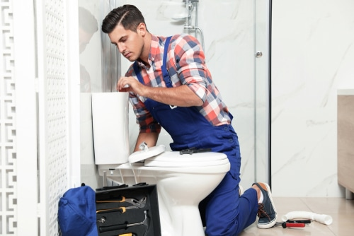 How do plumbers unclog toilets