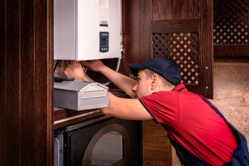 How do professionals repair water heaters